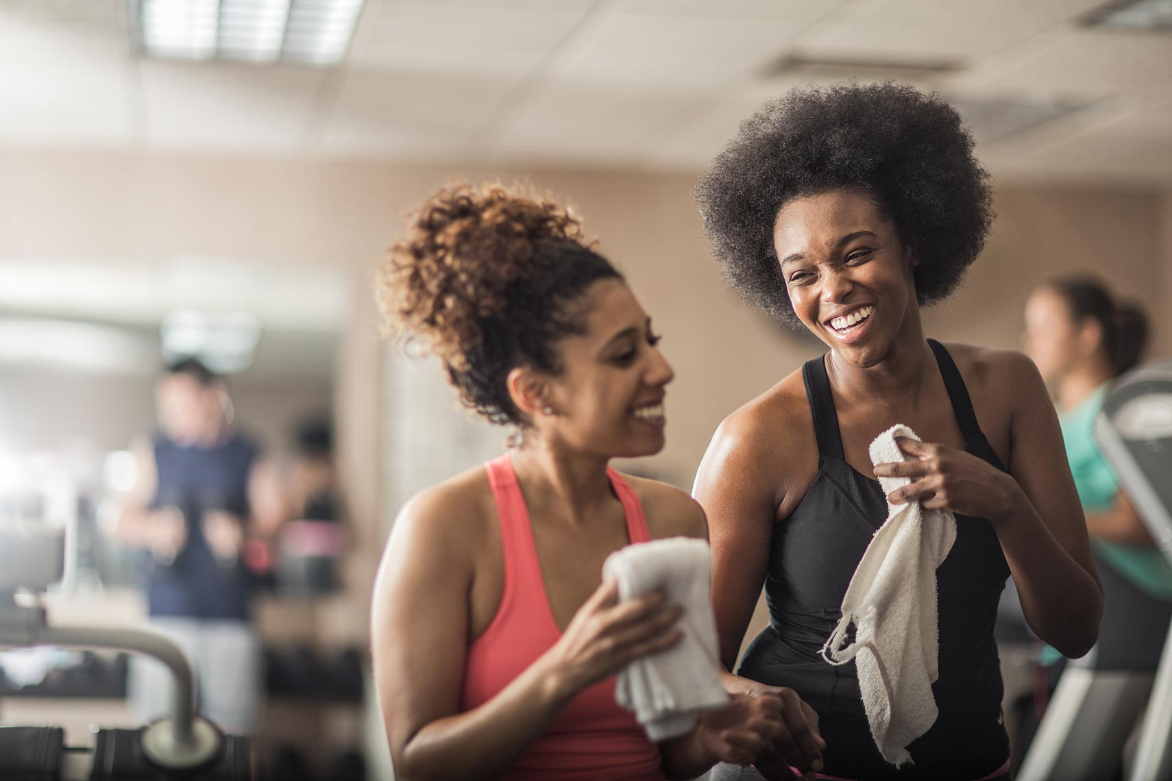 Friends laughing after a work out. | John Fedele Lifestyle Photography