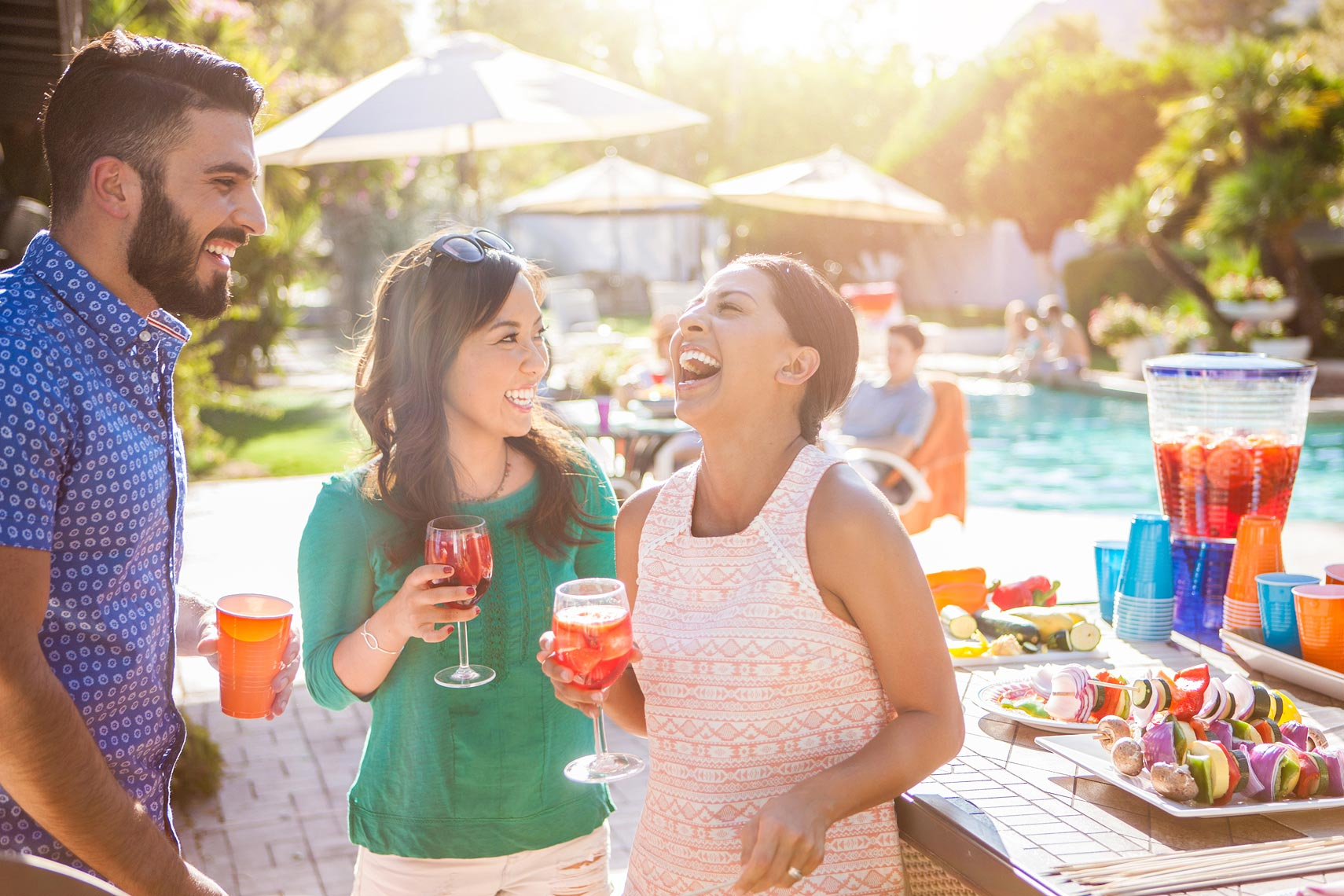 Friends laughing at a backyard pool party | OneAZ | John Fedele Lifestyle Photography