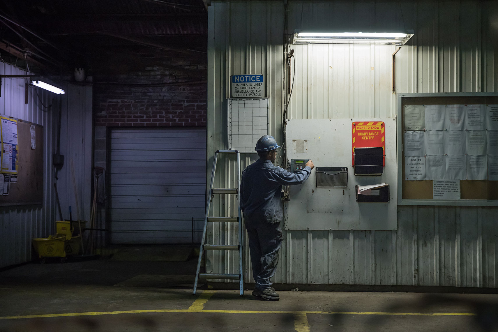 Industrial worker clocking in | Gamut | John Fedele Industrial Photography