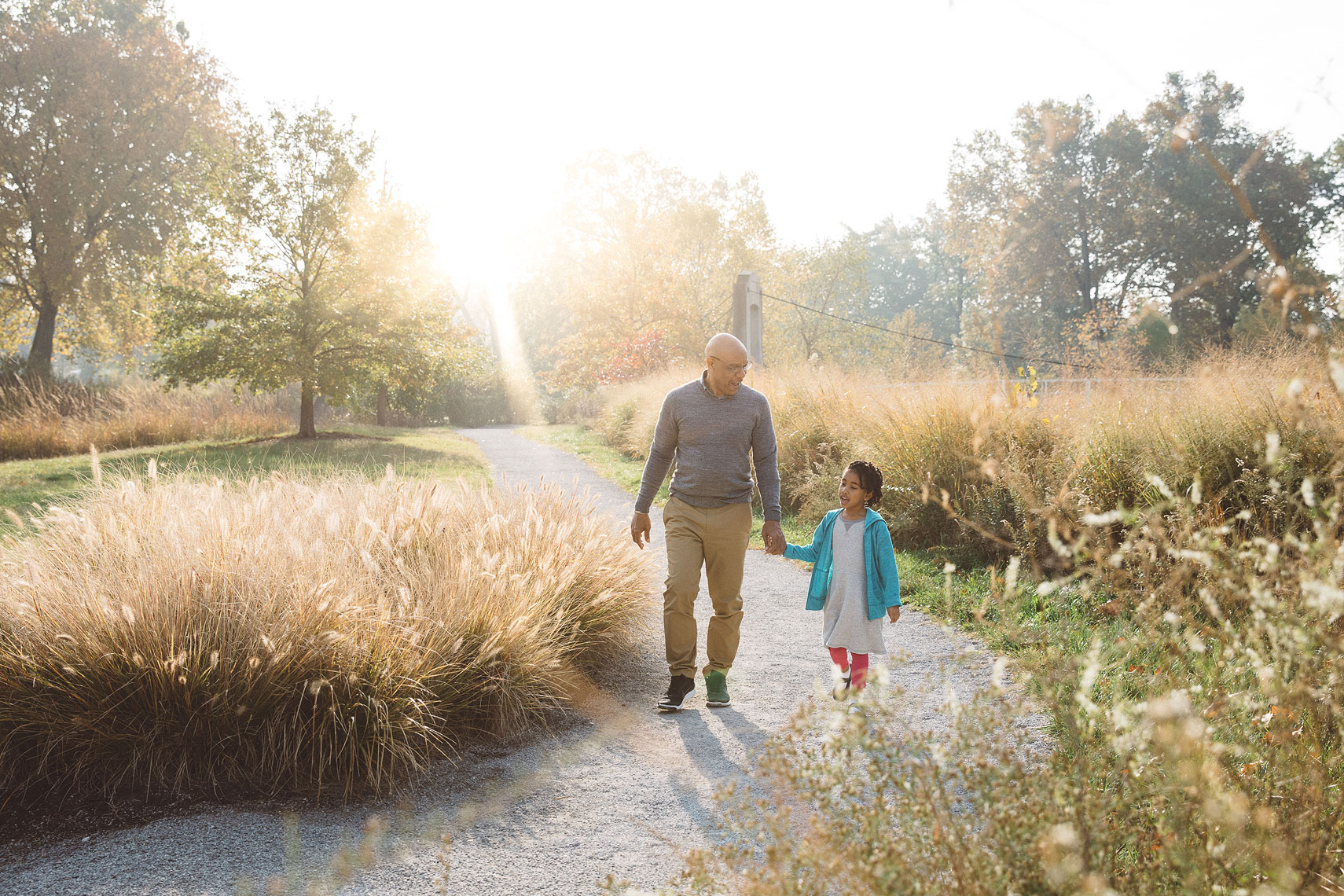 Grandfather walking with granddaughter in park |  Centene | John Fedele Lifestyle Photography