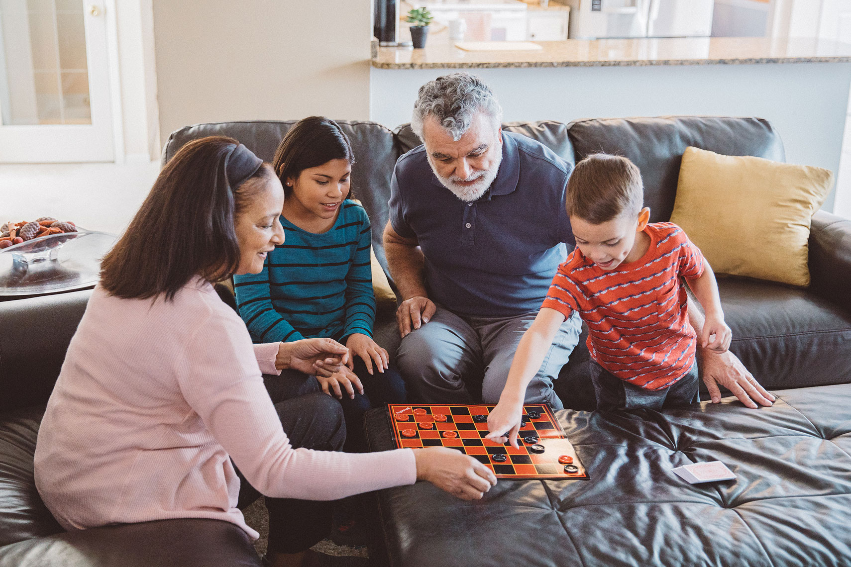 Grandparents playing checkers with children | Centene | John Fedele Lifestyle Photography