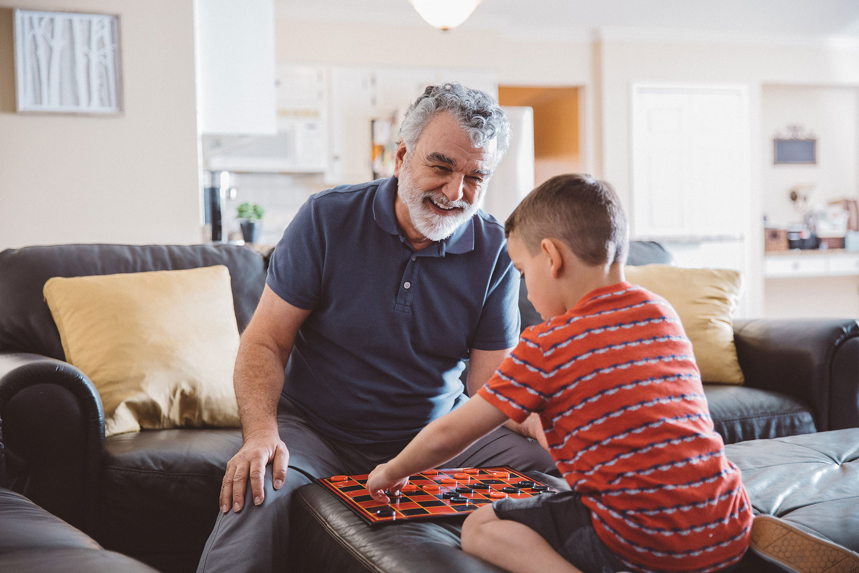 Grandfather and Grandson playing checkers |  Centene | John Fedele Lifestyle Photography