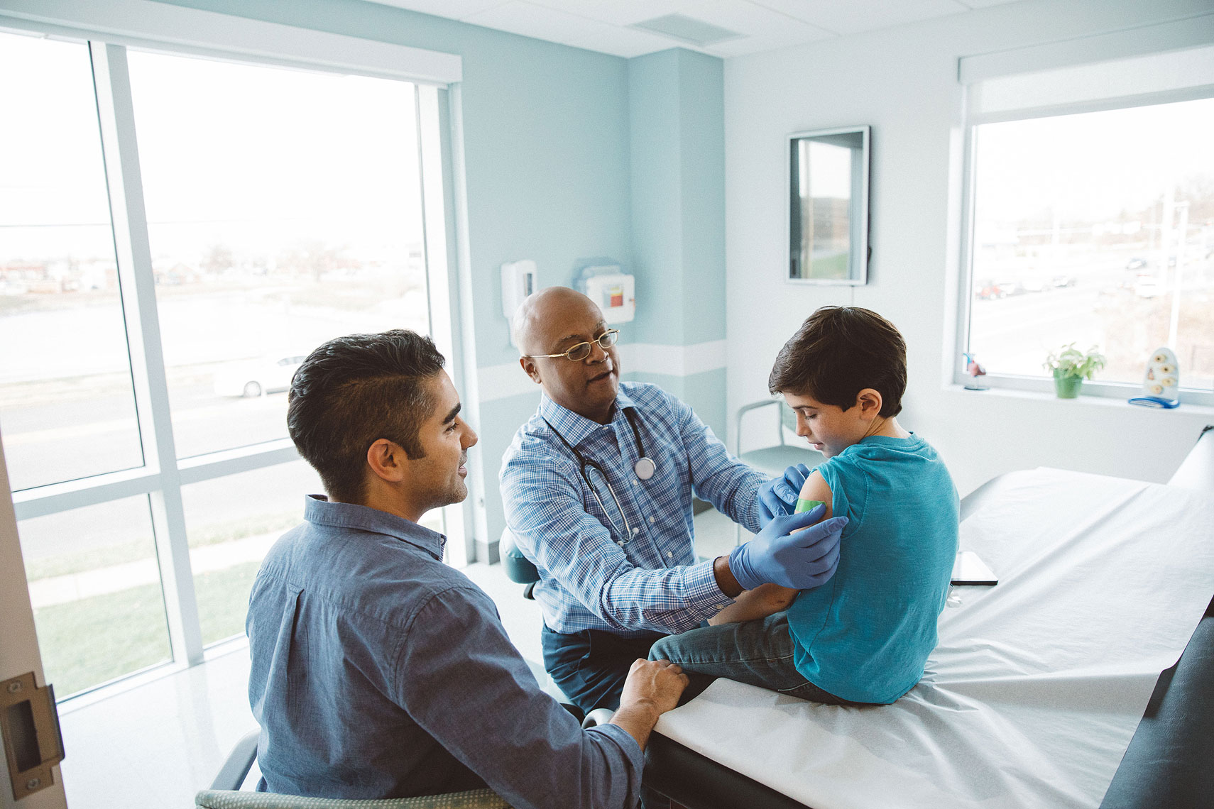 Doctor with a child and his father |  Centene | John Fedele Lifestyle Photography