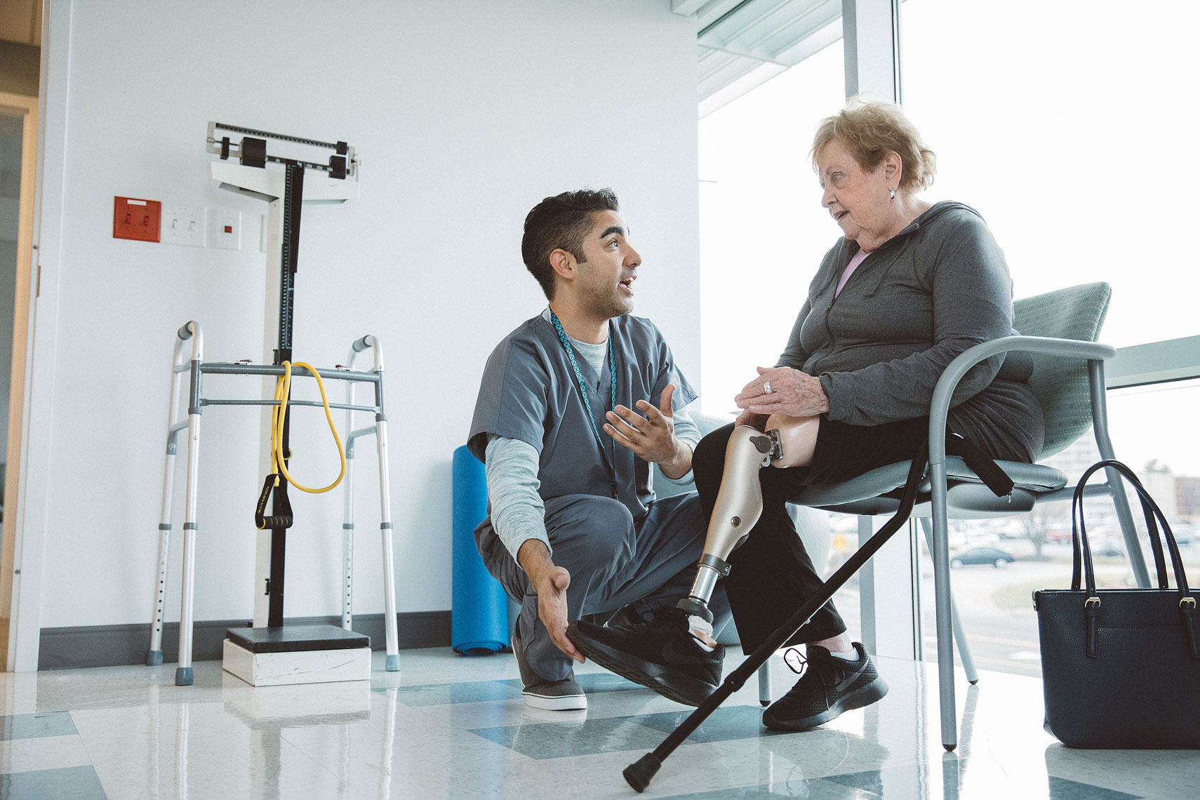 Women discussing her prothetic leg with a nurse |  Centene | John Fedele Lifestyle Photography