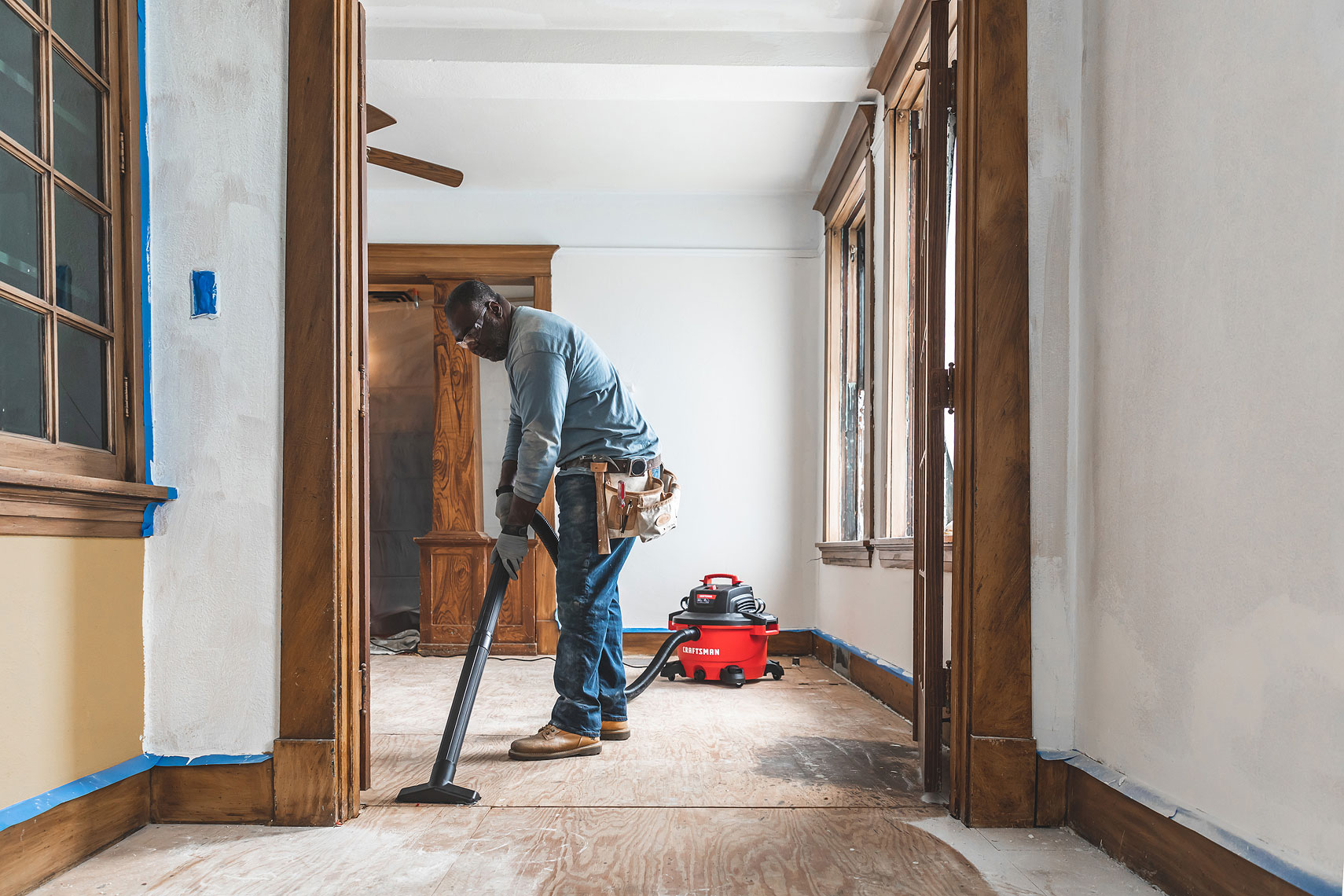 Craftsman Tools 12Gallon Wet/Dry Vacuum | Man vacuuming in a room remodel | John Fedele Product Photography
