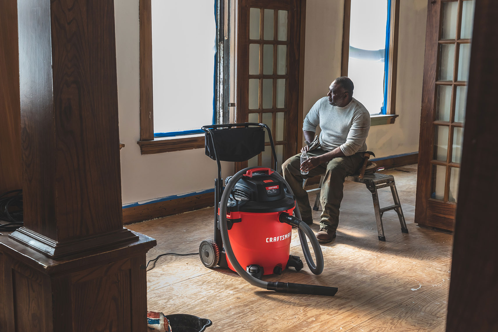 Craftsman Tools 20 Gallon Wet/Dry Vacuum | Man taking a break during a room remodel | John Fedele Product Photography