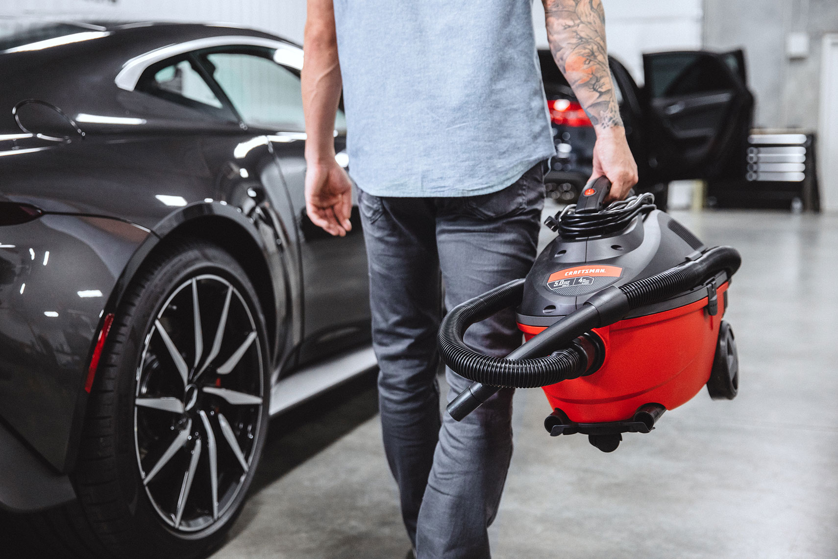 Craftsman Tools 4 Gallon Wet/Dry Vacuum | Mechanic walking near cars in garage. | John Fedele Product Photography