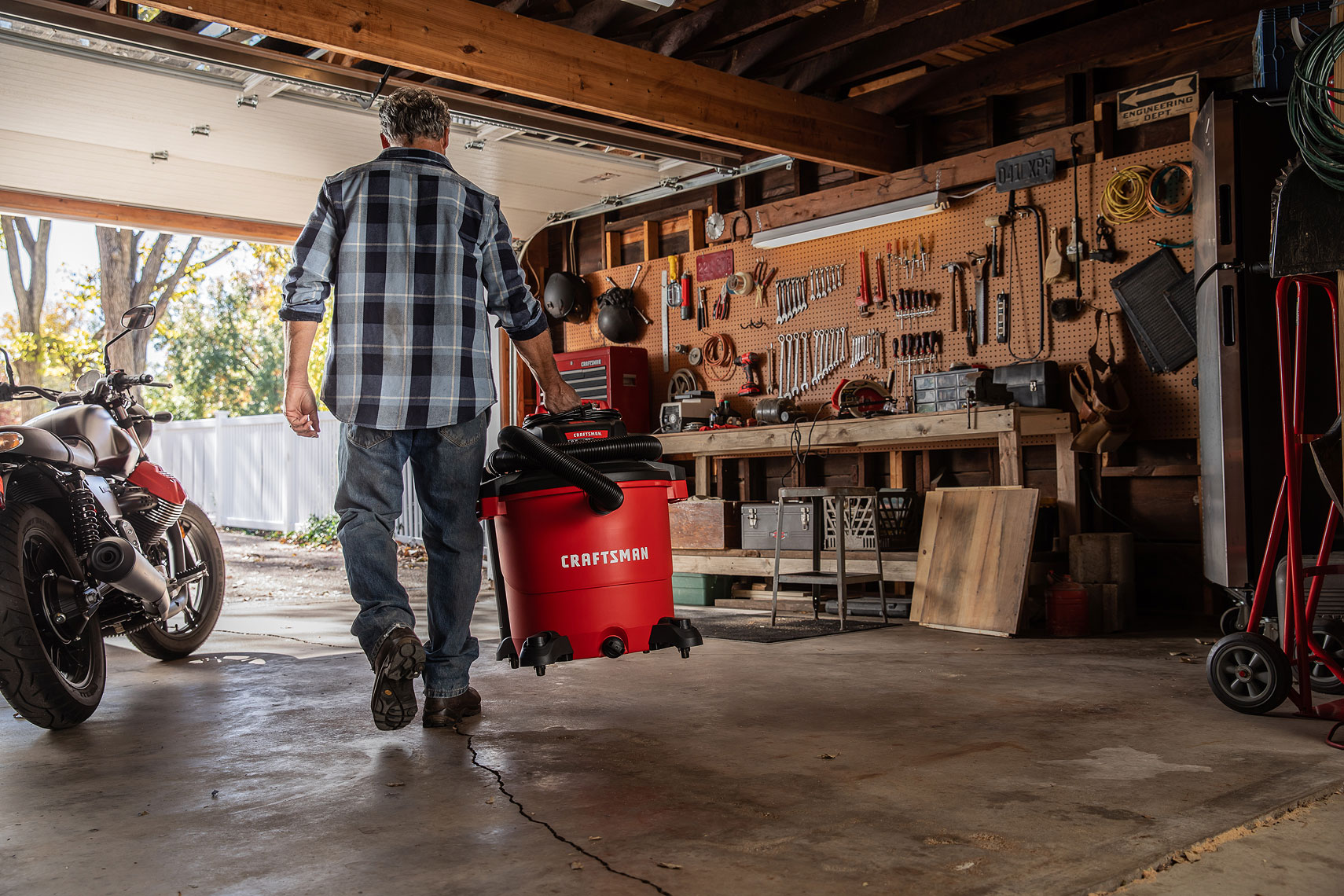 Craftsman Tools 20Gallon Wet/Dry Vacuum | Man carrying a vacuum in his garage.  | John Fedele Product Photography