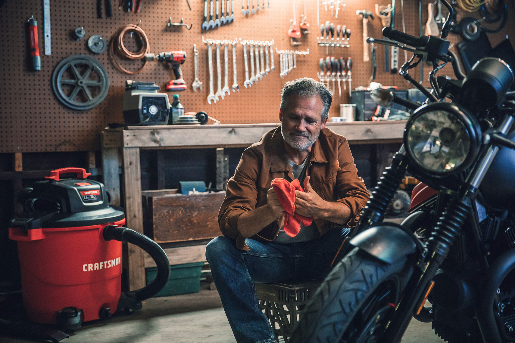 Craftsman Tools 20Gallon Wet/Dry Vacuum | Man working on his motorcycle with Craftsman vac in the background. | John Fedele Product Photography