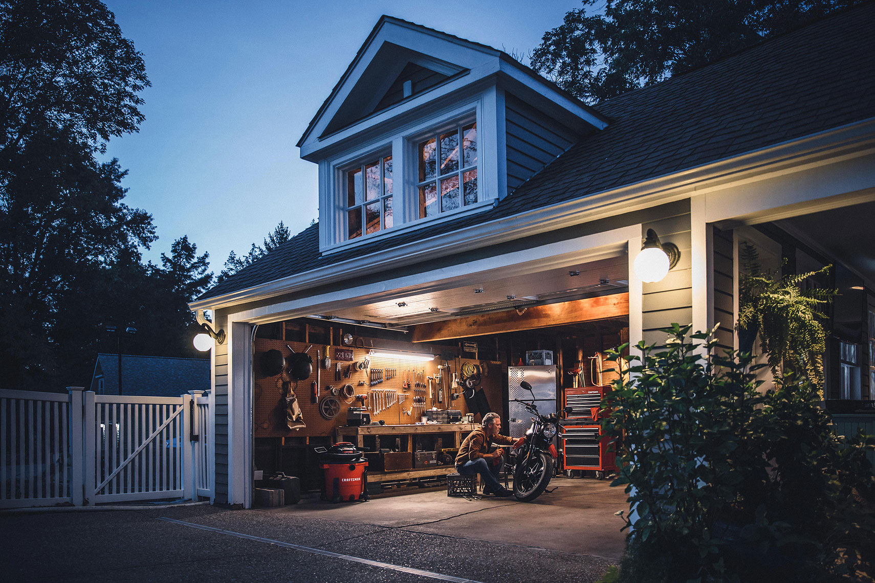 Craftsman Tools 20 Gallon Wet/Dry Vacuum | Man working on his Moto Guzzi motorcycle in his garage with Craftsman vac in the background. | John Fedele Product Photography