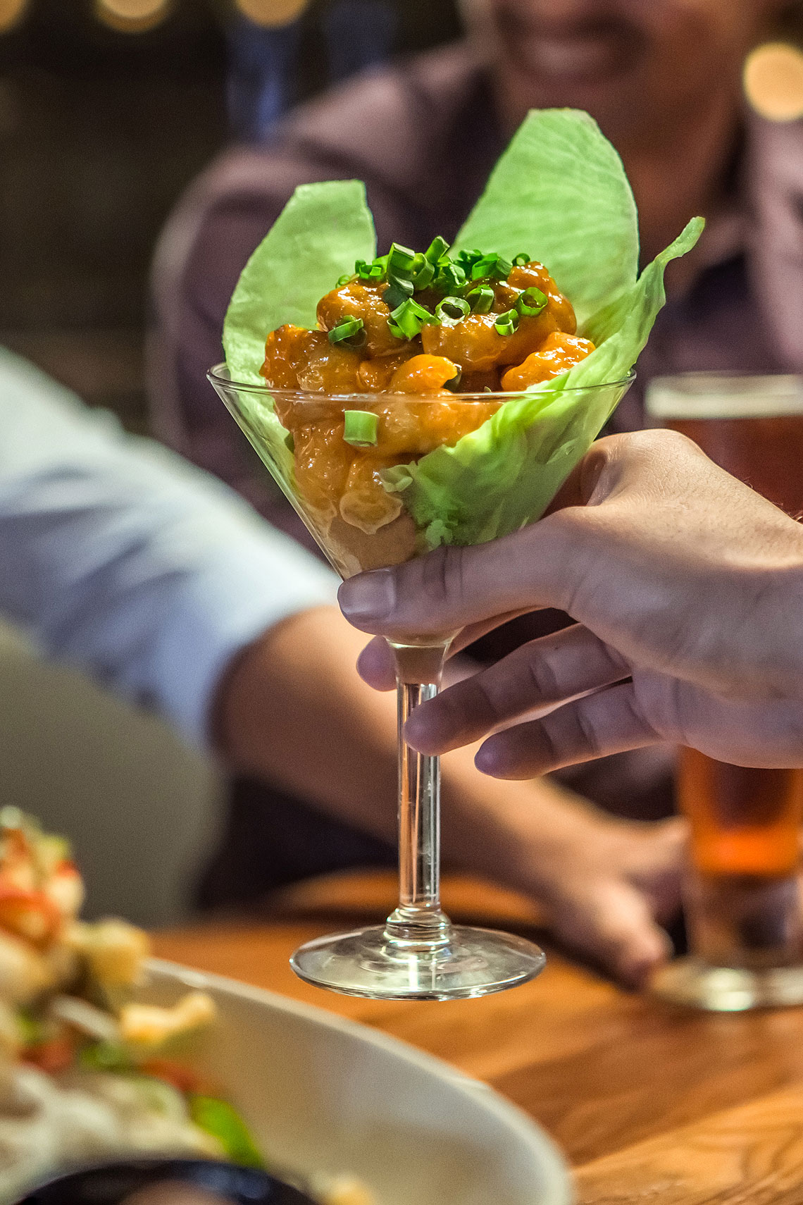 Close up of an appetizer in a martini glass. | P. F. Chang