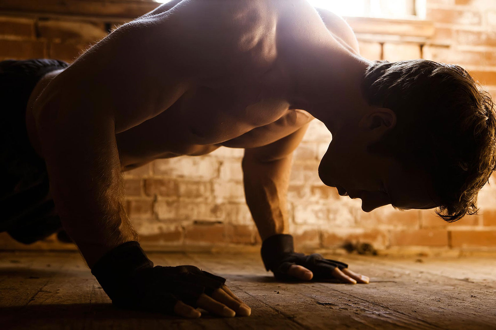 Close up of a man doing a push up. | John Fedele Lifestyle Photography
