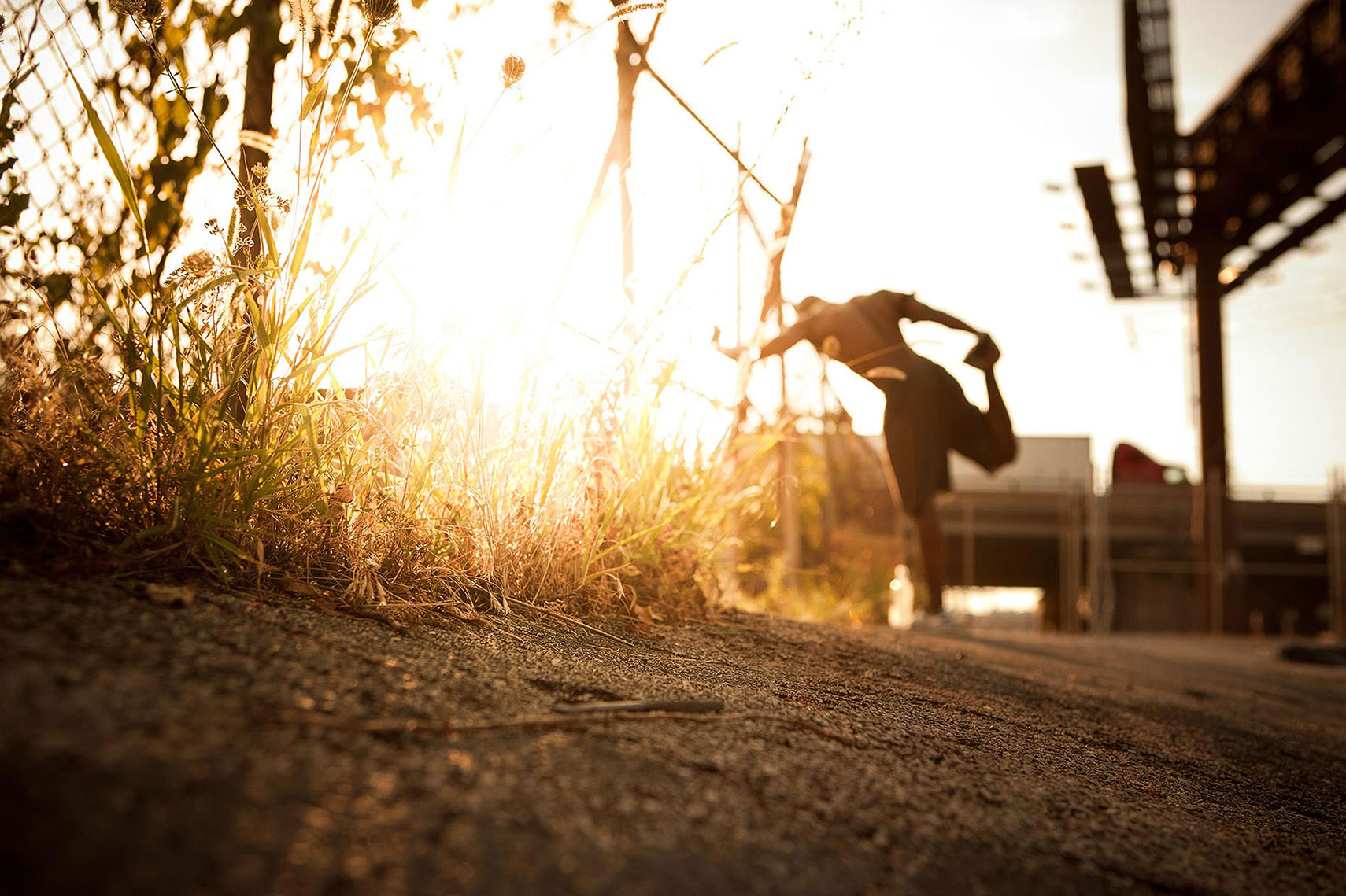 A man stretching before a run at sunset. | John Fedele Lifestyle Photography