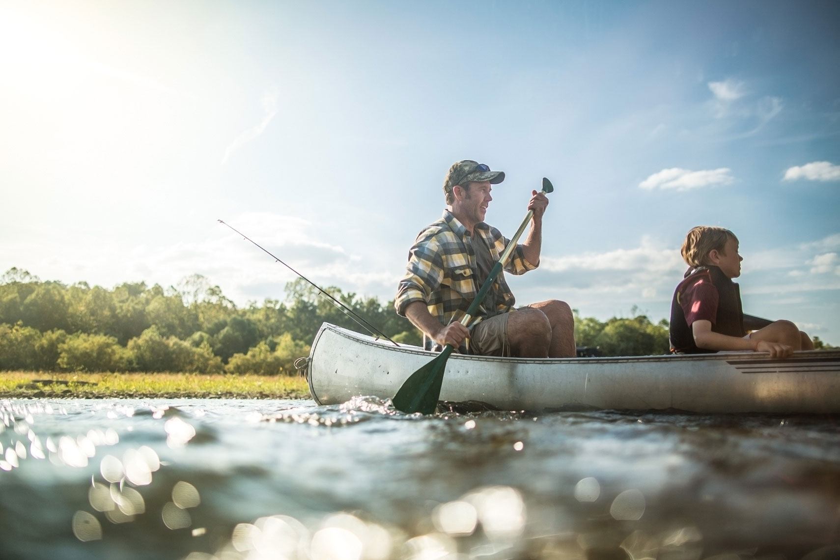 Father and son in a canoe on the river.  | John Fedele Lifestyle Photography