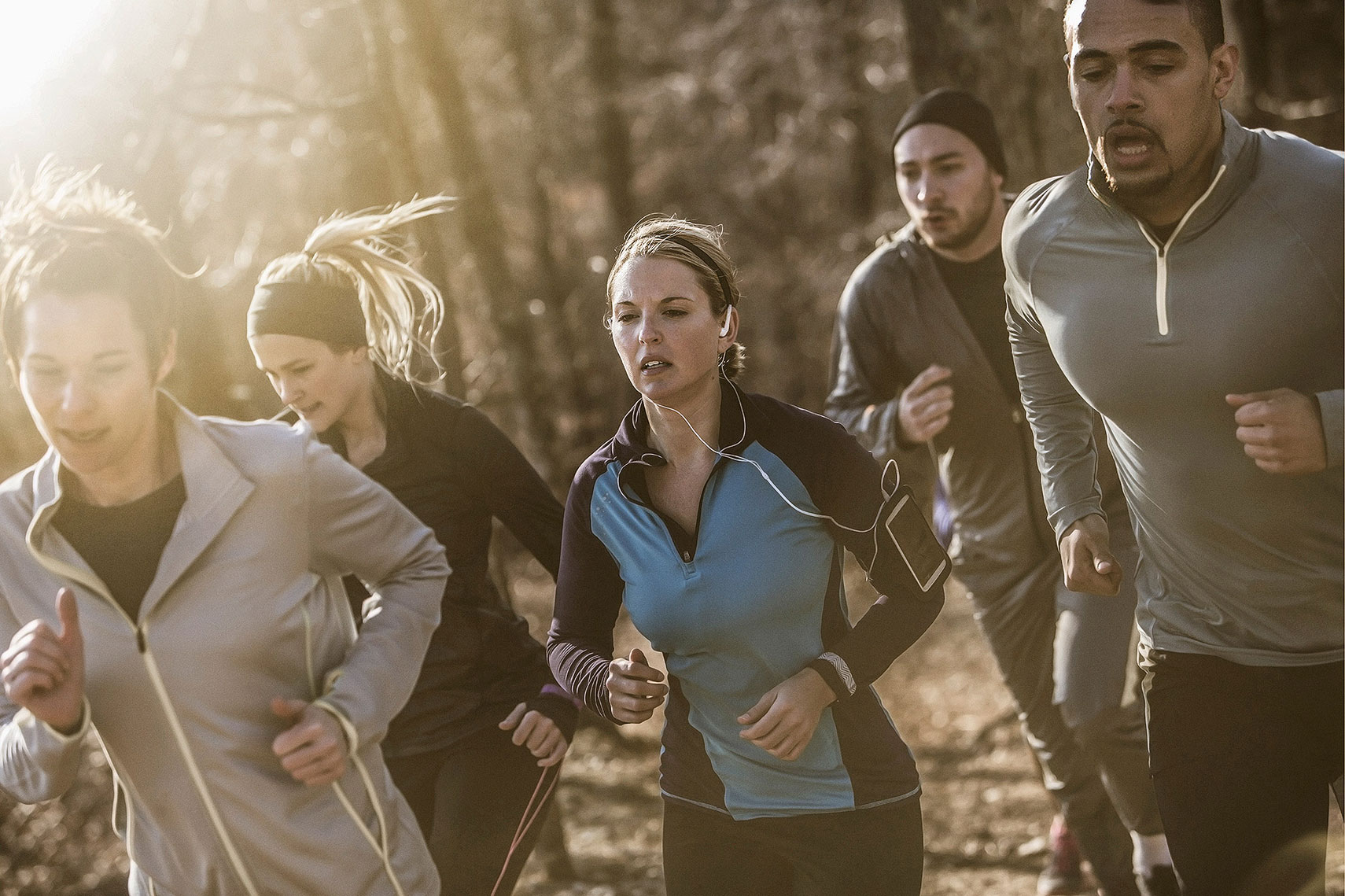A group of men and women running on a trail. | John Fedele Lifestyle Photography