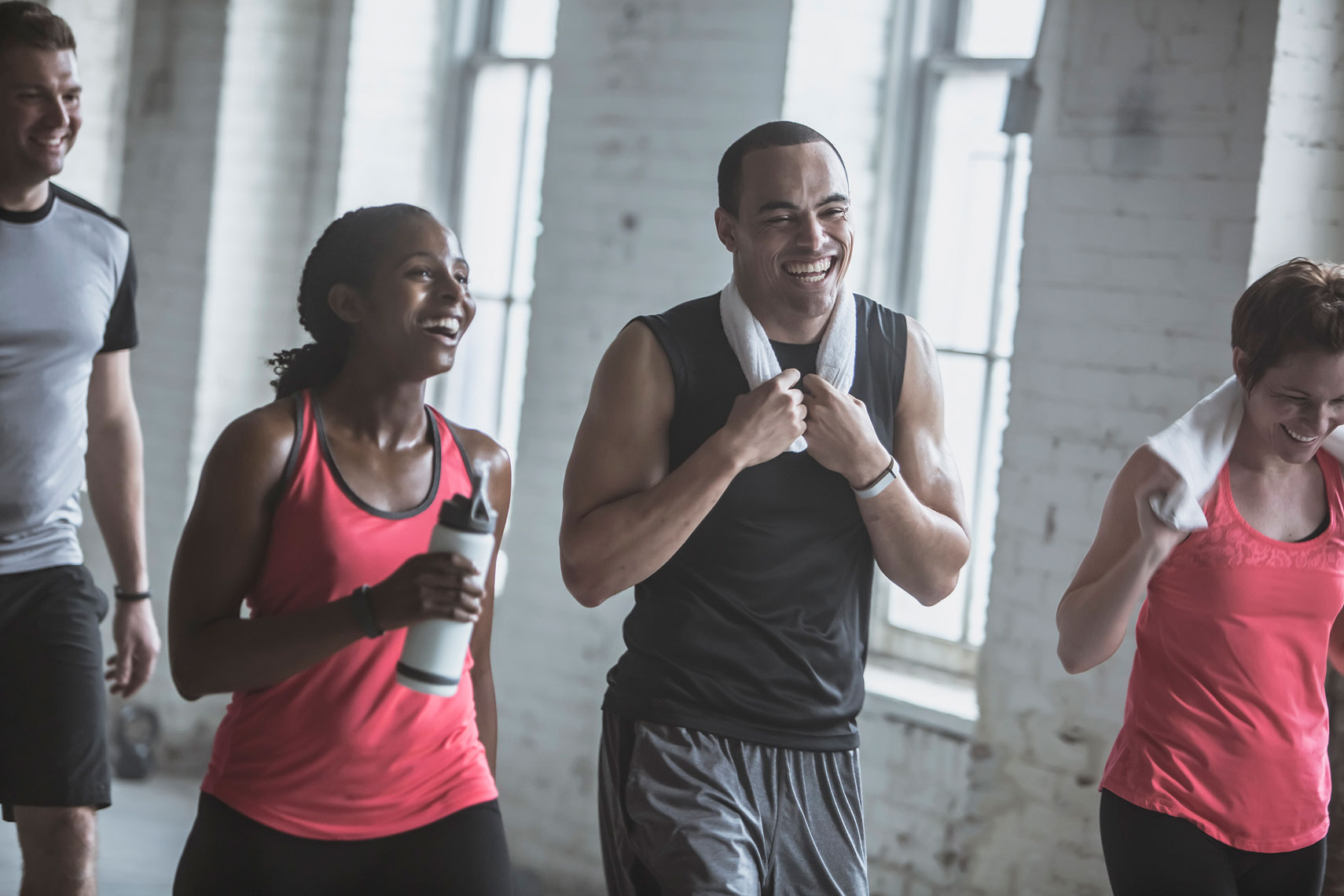 Friends laughing after finishing a work out. | John Fedele Lifestyle Photography