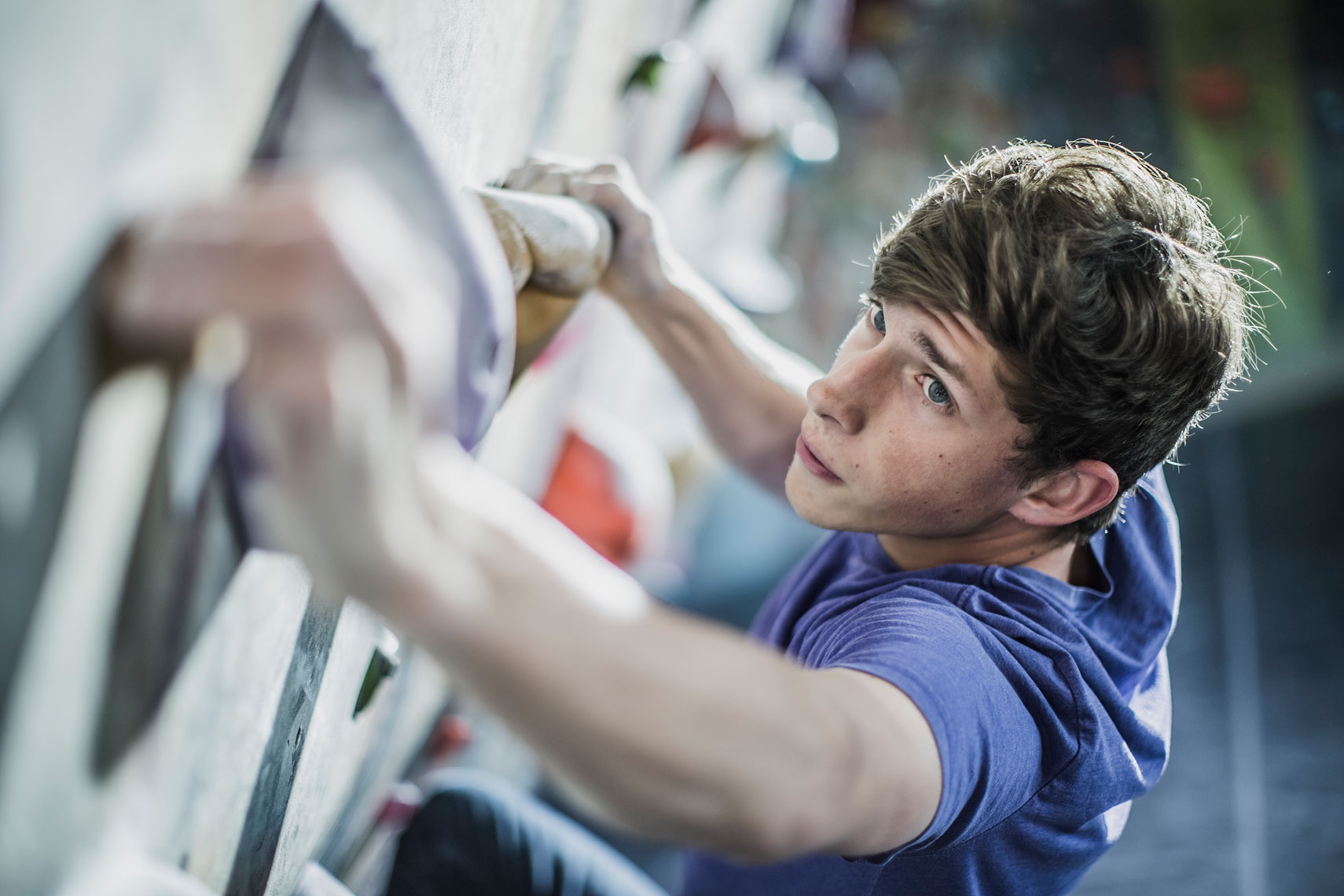 Man climbing at a climbing gym. | John Fedele Lifestyle Photography