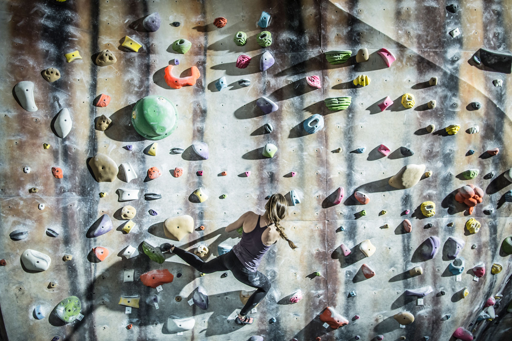 Woman climbing at a climbing gym. | John Fedele Lifestyle Photography