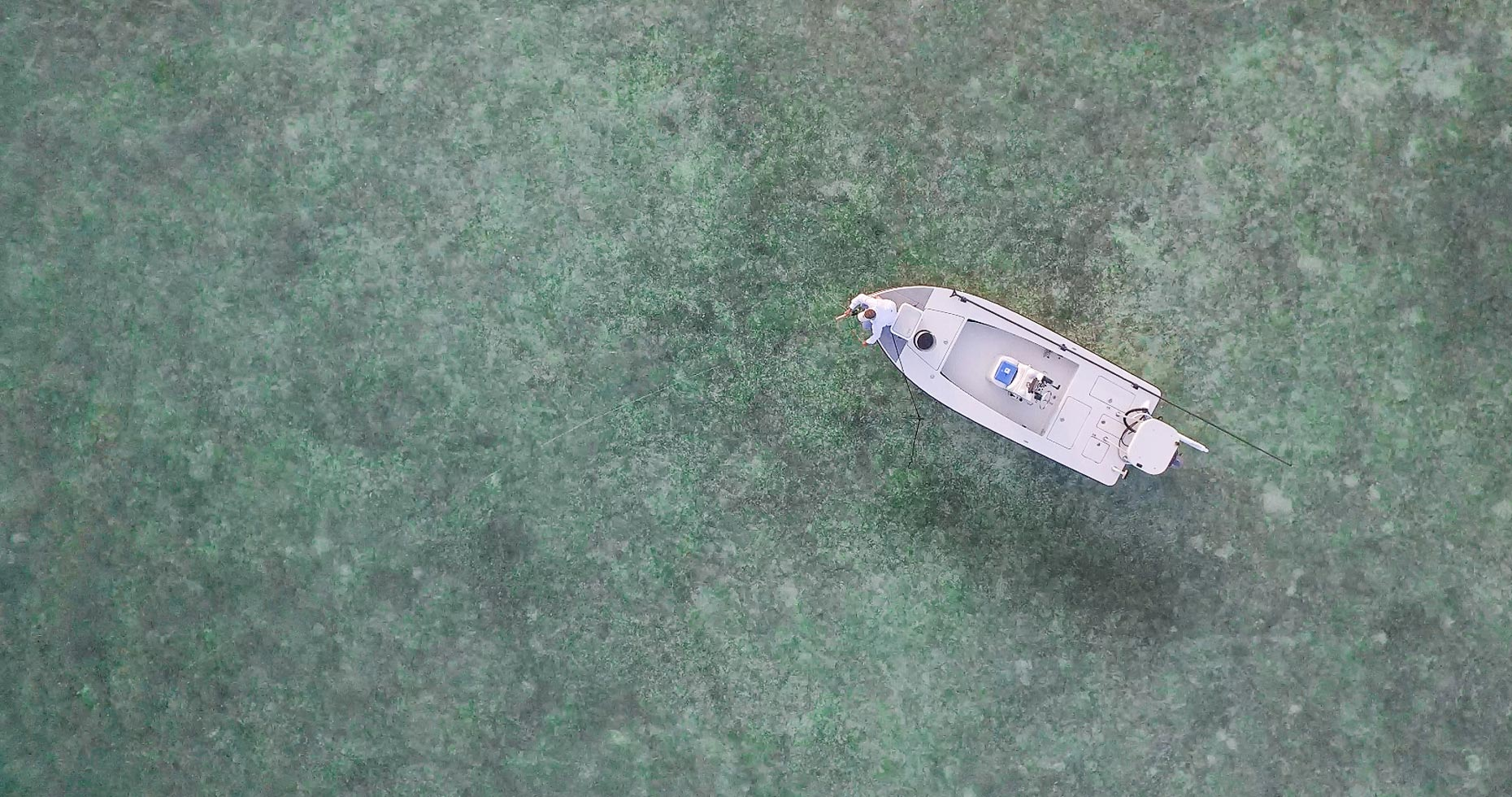 Overhead shot of a fishing boat in the open ocean. | John Fedele Lifestyle Photography