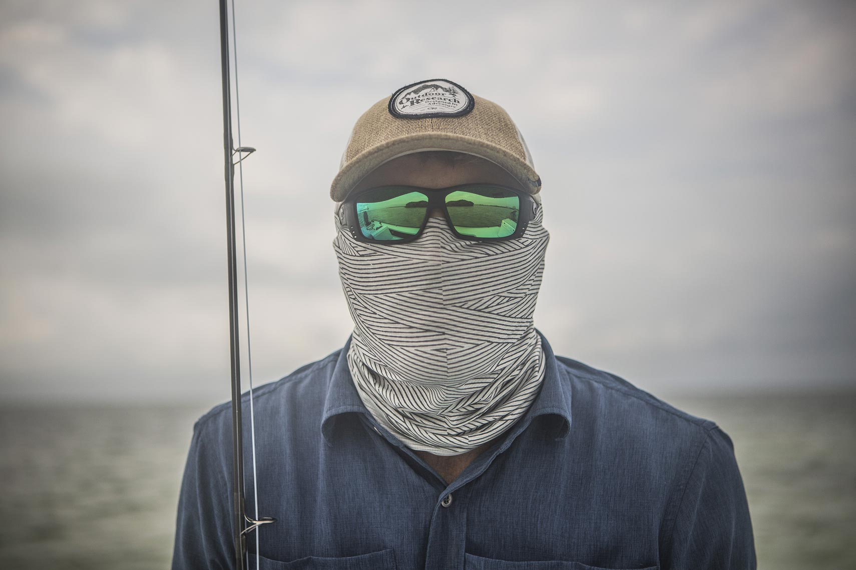 Close up of a fisherman with proper face and head attire for the open ocean  | John Fedele Lifestyle Photography