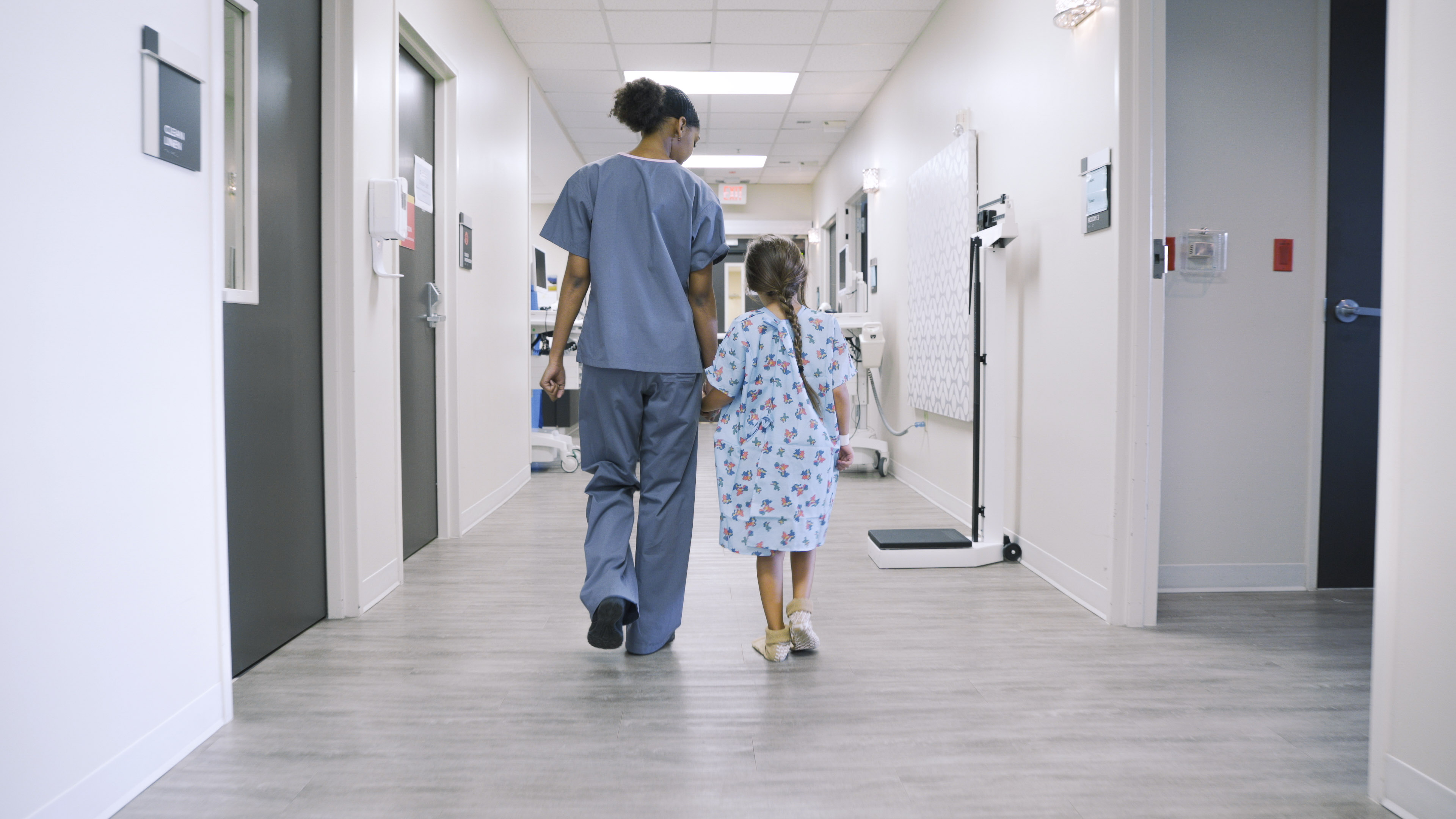 Nurse Holding  Hands with Child