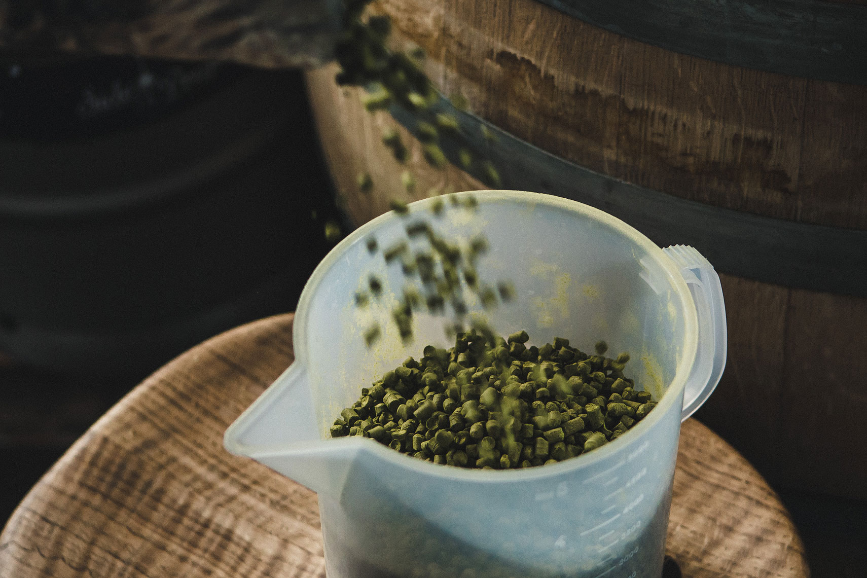 Hops pouring into container in beer making process. | Side Project Brewery | John Fedele Photography