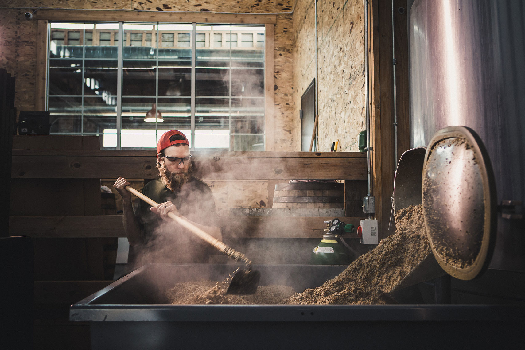 Brewer working with hops in a brewery | Side Project Brewery | John Fedele Photography