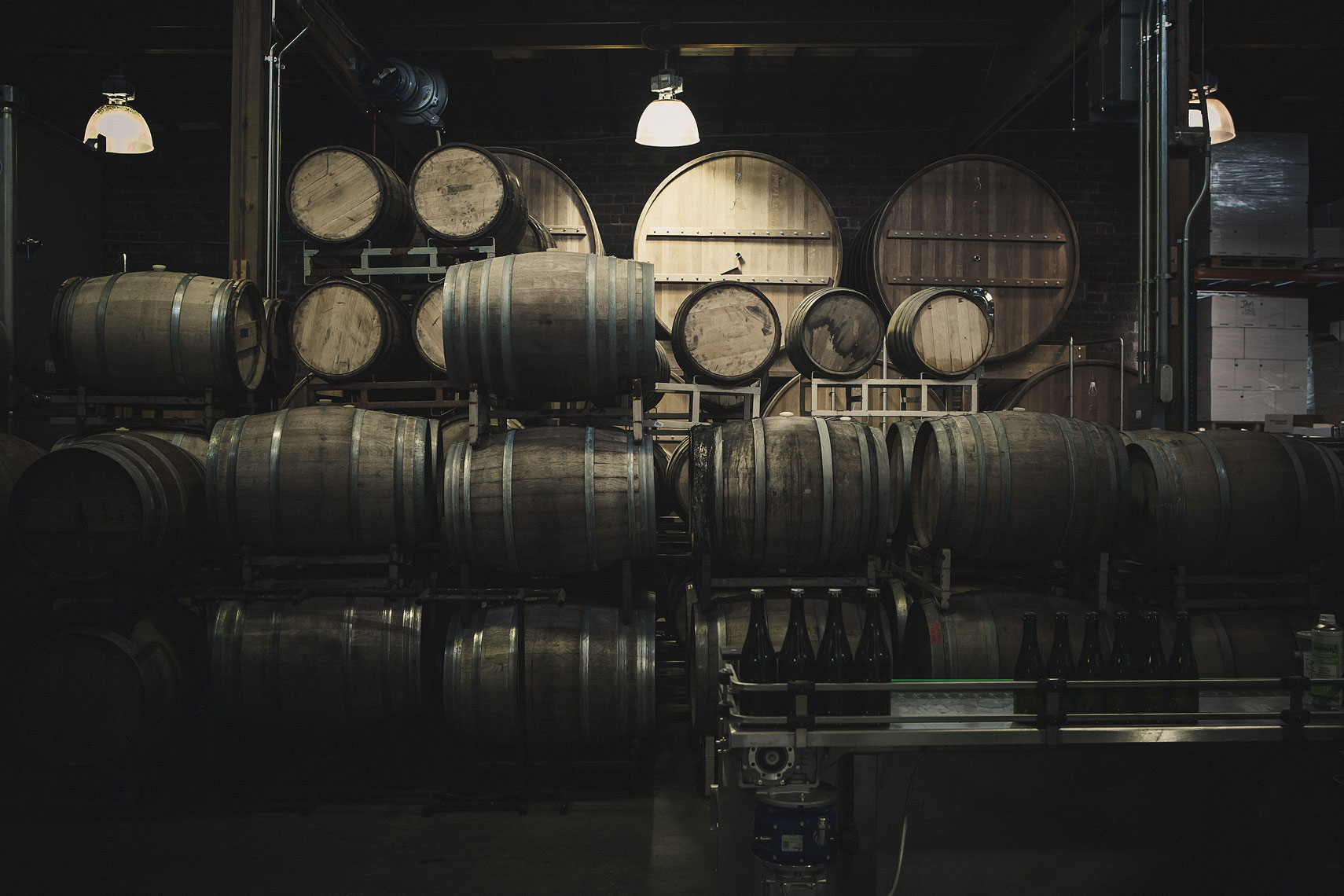 Aging whiskey barrels in a warehouse. | Side Project Brewery | John Fedele Photography