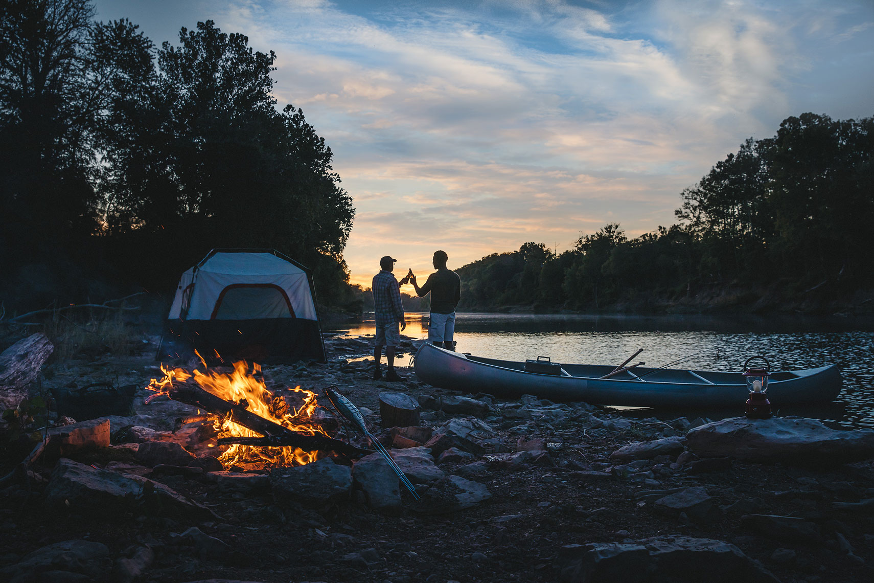 Two men cheers at their campsite. | John Fedele Lifestyle Photography