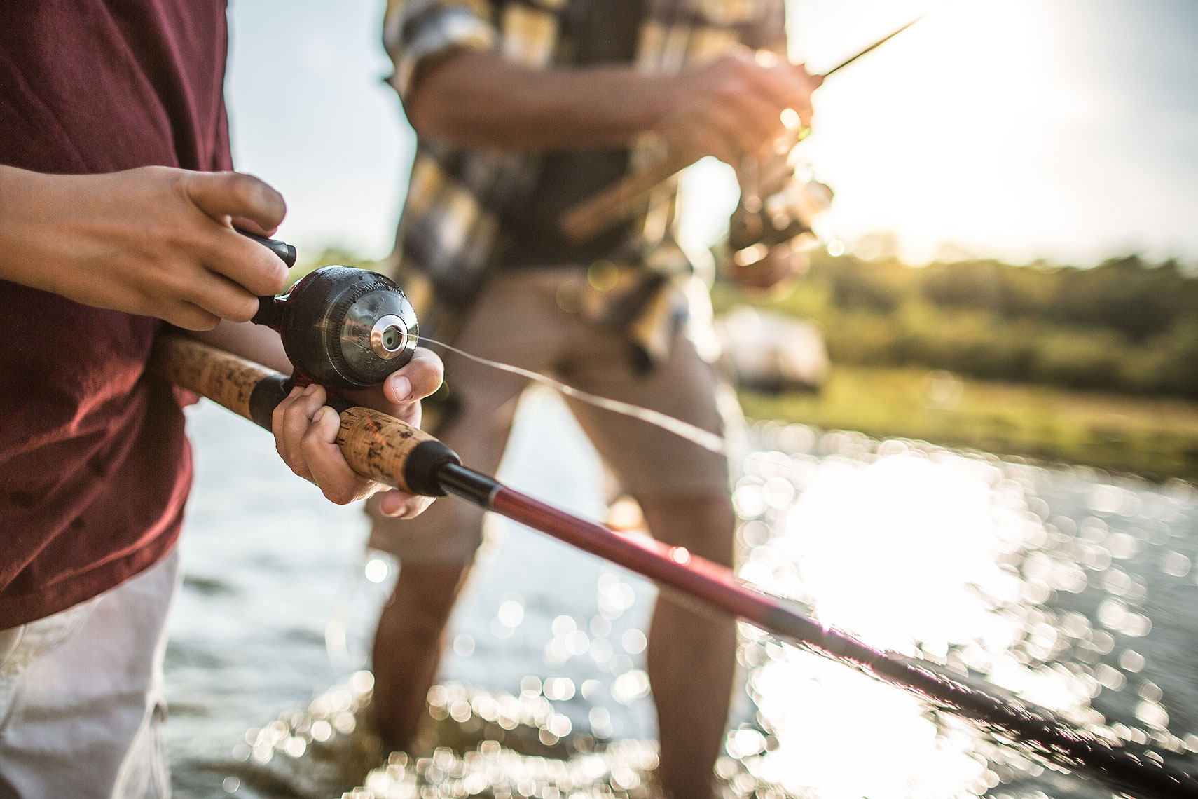 Close up of hands on a fishing rod.  | John Fedele Lifestyle Photography